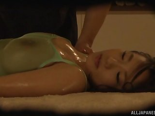 Oiled up busty Japanese babe missionary pounded and creampied
