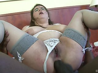 Broad in the beam mature Deborah sucks a black dick and rides rolling in money with her asshole