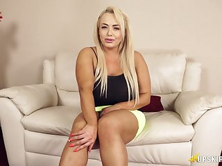Chubby blonde Jem Stone is flashing her pink bloomers and puffy pussy upskirt