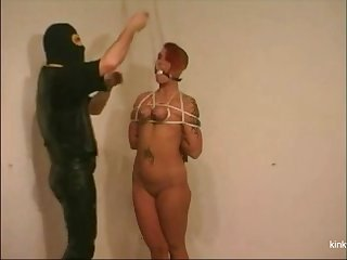 Slave girl Lindsey is dangling on the ceiling via the brush slutty mouth and tied tits.