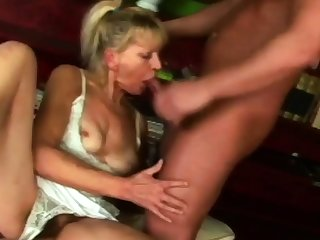 Hot granny is sucking her neighbour's big cock greater than the couch.