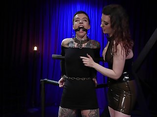 Mistress puts on a black strapon and fucks anus of tattooed babe Dana Spit