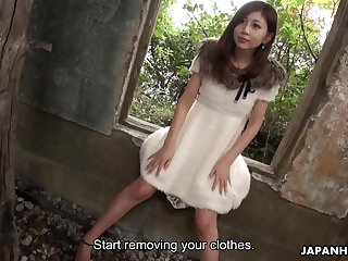 Depraved slim Japanese chick stripteases in deserted house and flashes hairy pussy